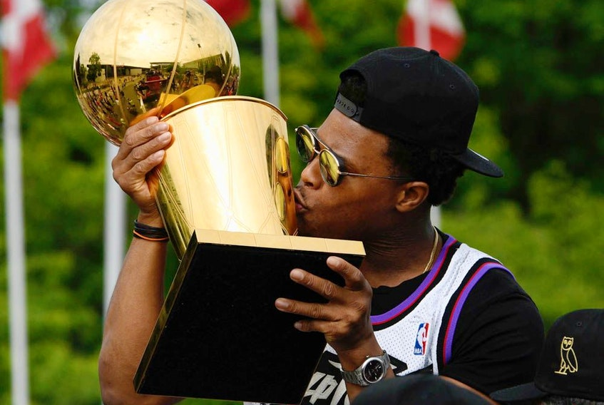 Toronto Raptors guard Kyle Lowry kisses the Larry O'Brien NBA Championship Trophy during Toronto Raptors victory parade celebration in Toronto, on June 17, 2019.