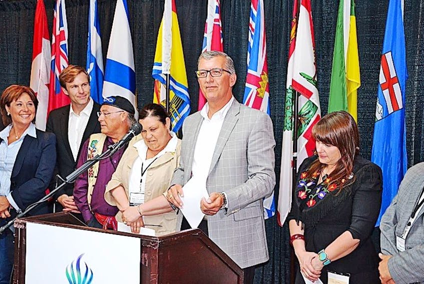 Premier Paul Davis, surrounded by Canada's Premiers and national Aboriginal leaders speaks at a press conference following a meeting about Aboriginal issues, held in Happy Valley-Goose Bay on July 15.