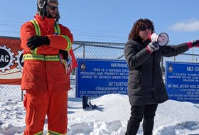 President of the local branch of the Union of National Defence Employees Jonathan Cull, left, and Colleen Coffee, regional executive vice-president for PSAC's Atlantic Region, spoke at the rally a few weeks ago. - CONTRIBUTED
