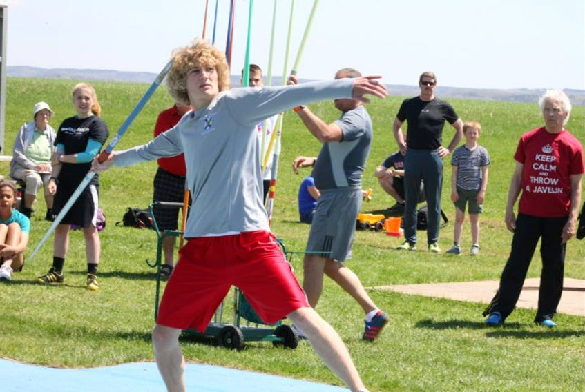 <p>NKEC student Owen Hebb competes in the javelin as part of the Throwing for Autism meet May 16 in New Minas. Hebb, normally a runner and jumper, has taken up javelin, discus and shot put this year as part of his quest to compete in the decathlon, which includes throwing events.</p>