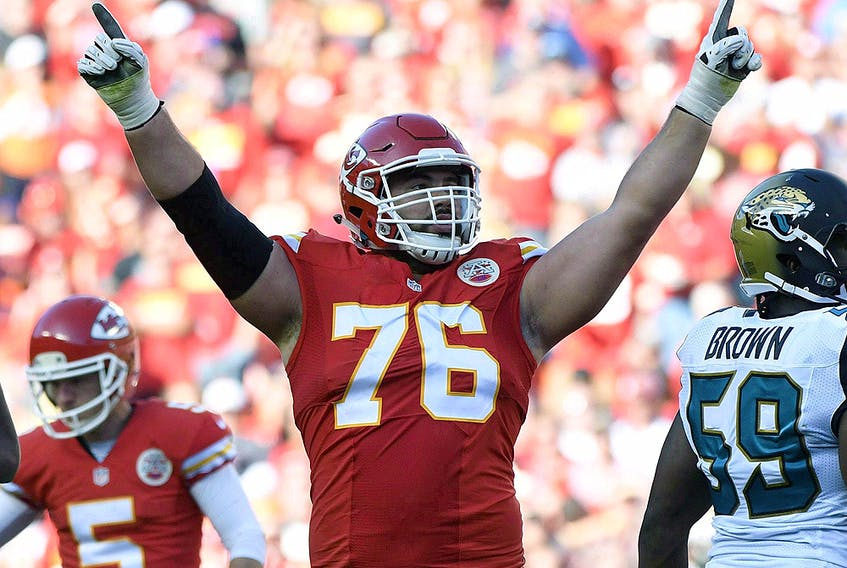 Kansas City Chiefs' Laurent Duvernay-Tardif (76) is introduced before the AFC championship game against the Tennessee Titans Sunday, Jan. 19, 2020, in Kansas City. (AP Photo/Jeff Roberson)