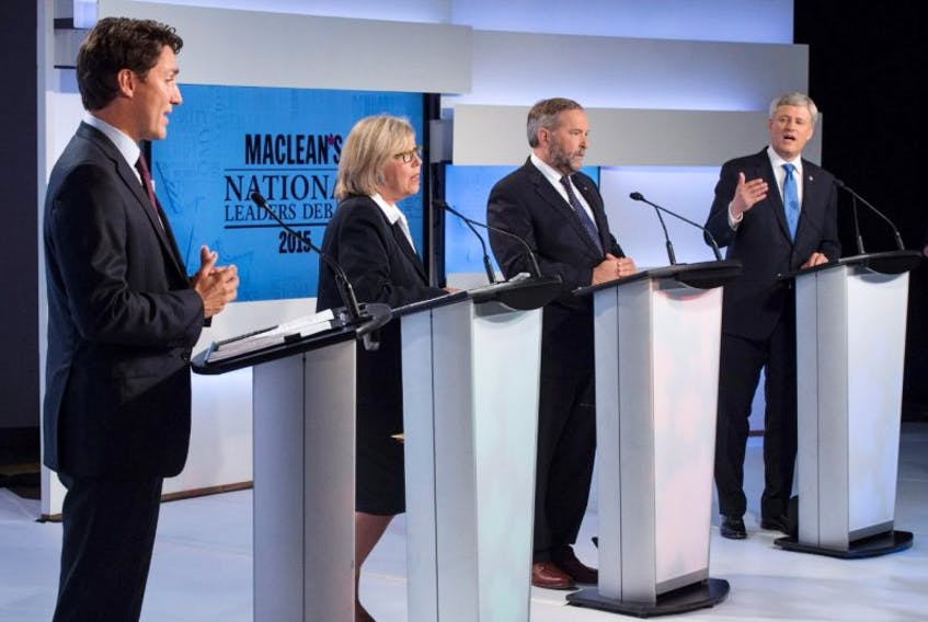 Liberal leader Justin Trudeau, Green Party leader Elizabeth May and New Democratic Party leader Thomas Mulcair listen as Conservative Leader Stephen Harper take part in the first leaders debate Thursday, August 6, 2015 in Toronto.