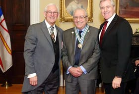 Dr. Falah Maroun (centre) receiving the Order of Newfoundland and Labrador in 2015 from then-lieutenant-governor Frank Fagan (left) and then-premier Dwight Ball. CONTRIBUTED