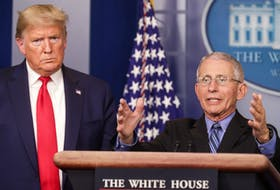 U.S. President Donald Trump listens as Dr. Anthony Fauci, director of the National Institute of Allergy and Infectious Diseases, addresses the coronavirus task force daily briefing at the White House in Washington, D.C., Wednesday. — Reuters/Jonathan Ernst