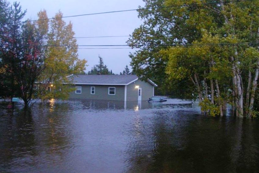 Flooding damaged homes in Brown's Arm, NL, last year. Climate change may make overland flooding a larger risk for for Canadian homeowners.