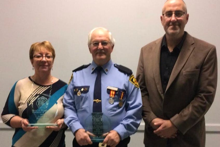The Town of Summerford honoured Calvin Wheeler and Wayne Small for their outstanding volunteer service while Holly Gates received the Volunteer of the Year award. Pictured are (from left) Gates, Wheeler and Mayor Kevin Barnes. Missing from photo is Wayne Small.