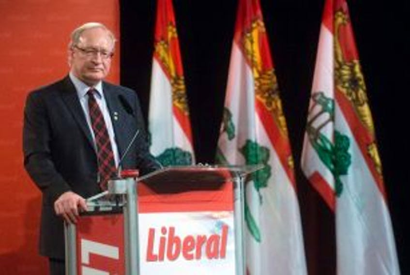 """[""""P.E.I Premier designate Wade macLauchlan speaks to the Liberal leadership convention in Charlottetown Saturday. MacLauchlan will become the Island's 32nd premier when he is sworin into office Monday.""""]"""