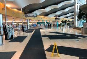 This March 2020 file photo shows an empty St. John's airport terminal just after pandemic measures were introduced. The airport authority has mandated all passengers and staff wear masks in the building as of Friday in anticipation of increased traffic from relaxed Atlantic Canada border rules.