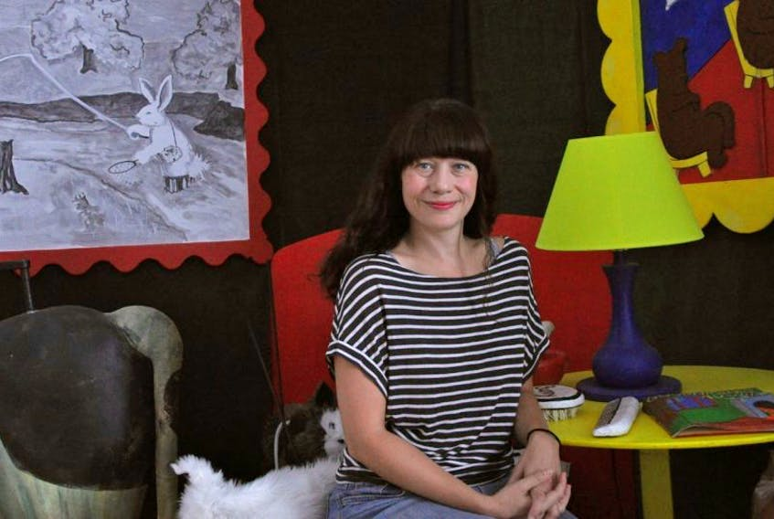 <p>Lisa Gleave, pictured taking a break from her day job at Mermaid Theatre's headquarters in Windsor, has no regrets about purchasing a home less than a year before council decided to start looking into dissolution.&nbsp;</p>