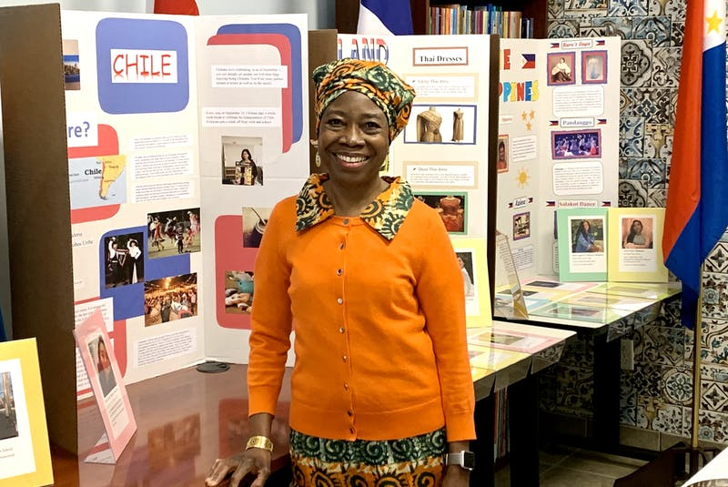 Lloydetta Quaicoe poses in front of students' culture projects at the Sharing Our Cultures office in St. John's. She says it's important for children to celebrate their identities. – ROSIE MULLALEY/The Telegram