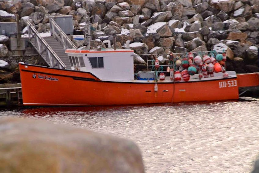 <p>Total Confusion rests at the Lower Sandy Point Wharf last week. According to a local buyer there has been little rest this year for hundreds of fishermen in LFA 33 who are enjoying higher prices and catches.</p>