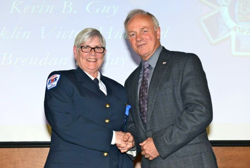 <p>Odette Gaudet of Church Point receives a long service award from Health Minister Leo Glavine. A second Clare paramedic, Peter Maillet of Meteghan, was also honored.</p>