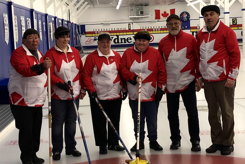 After winning the championship last February, the Louise Gillis rink will defend its title this year as Team Canada when they participate in the Canadian Visually Impaired Curling Championship in Ottawa this week. Members of the team, from left, Sidney Francis (coach/guider), Terrylynn MacDonald, Louise Gillis, Mary Campbell, Garth Nathanson (coach/guider) and John Marusiak (coach/guider). PHOTO SUBMITTED/LOUISE GILLIS.
