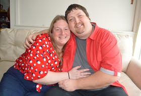 Melanie Denny of Glace Bay and Richard Carrigan of New Waterford spend an affectionate moment together at the Ally Centre of Cape Breton in Sydney where they are both employed. The couple met 15 years ago when both — addicted to opioids — were being treated at the Mental Health and Addiction Services unit at the Cape Breton Regional Hospital in Sydney. The couple say the addiction battle is a lifetime challenge, but they are winning the war through their love for each other, a story they share on Valentine's Day. Sharon Montgomery-Dupe/Cape Breton Post