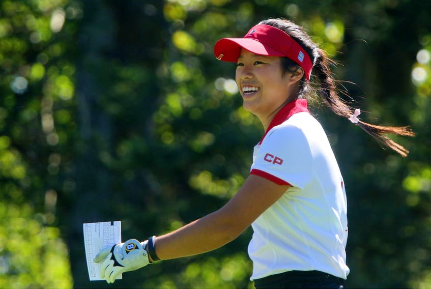 Calgarian Jaclyn Lee is all smiles after her shot from the first tee during round 2 of the Canadian Pacific Women's Open at Priddis Greens Golf and Country Club west of Calgary, Alta.,  August 26, 2016. Leah Hennel/Postmedia