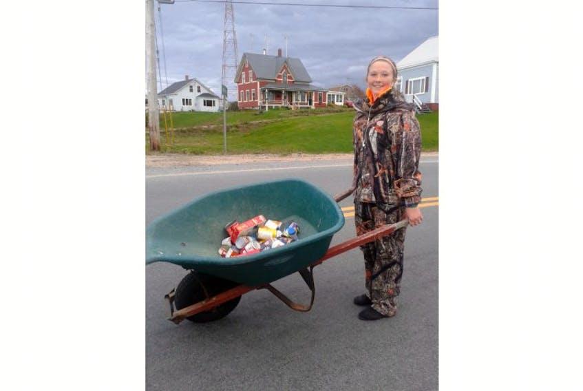 <p>Mackenzie Crocker of Tiverton collected three wheelbarrows full of food for the foodbank at Hallowe'en.</p>