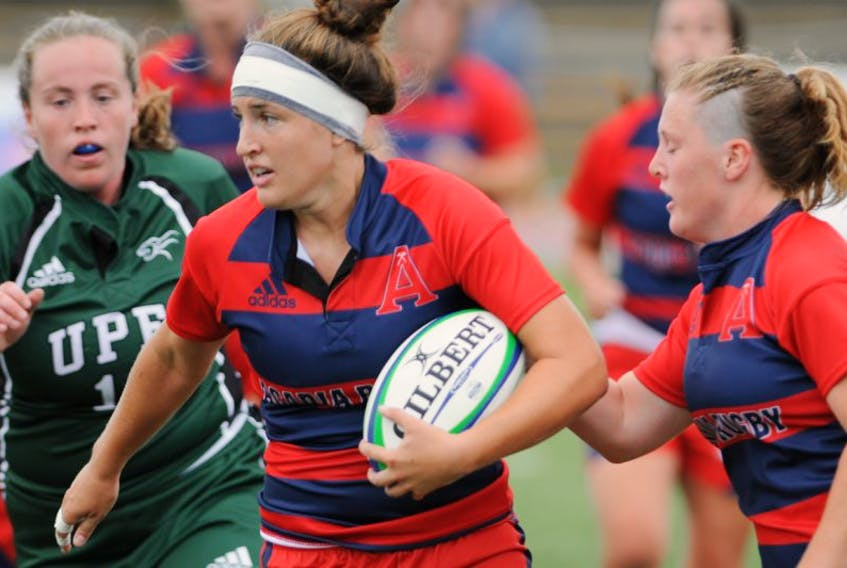 <p>Axewomen rugby player Maddie Mackenzie (with the ball) missed all last season due to injury, but is making up for lost time this season, helping lead Acadia to a 4-0 record, including a win over St. F.X. in Antigonish.</p>
