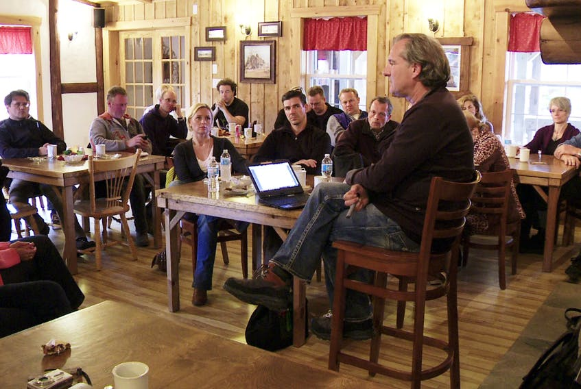 """In this undated photo, Andreas Popp, described as a well-known right-wing radical and conspiracy theorist by German magazine Spiegel, speaks with Europeans interested in buying real estate during one Popp's seminars in Cape Breton. A report in German media Thursday accused Popp and his partner Eva Herman of building a """"right-wing colony"""" in areas along the Bras d'Or Lake in Richmond County and in doing so selling property lots at inflated prices. Wissensmanufaktur.net photo"""