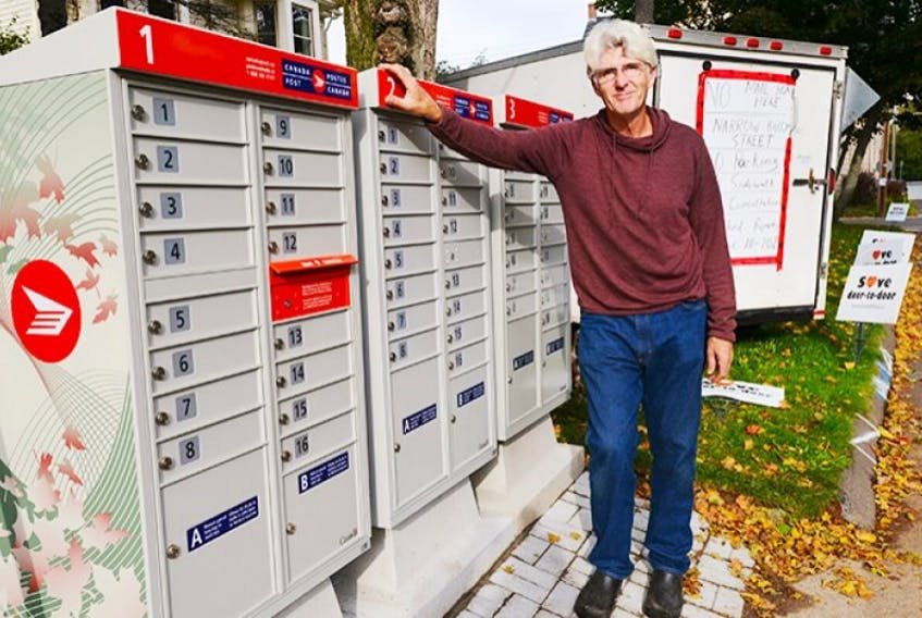 """<span>William """"Woody"""" White stands beside the community mailbox he fought to keep Canada Post from installing on his property on Upper Prince Street in Charlottetown.</span>"""