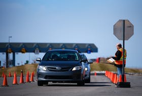 Cars wait in line in March at the Covid-19 checkpoint at the Confederation Bridge in Borden-Carleton. Nathan Rochford/The Guardian