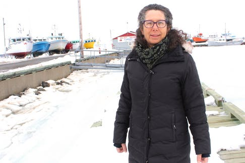 Veronika Brzeski stands near the North Sydney wharf. The executive director of the Cape Breton Fish Harvesters Association says she expects both certain and uncertain challenges in this year's lobster season. ERIN POTTIE/CAPE BRETON POST