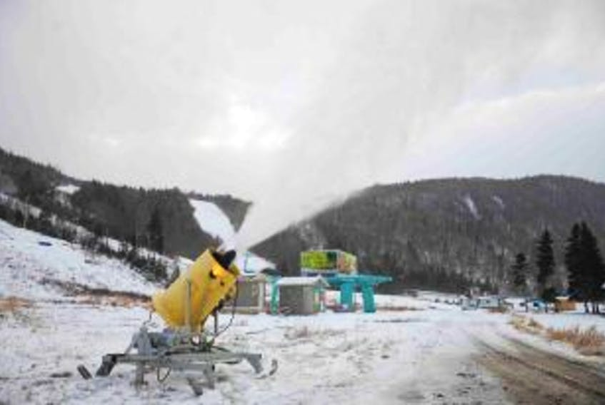 ['The first snow gun at Marble Mountain began producing artificial snow at the base of the ski hill Monday afternoon.']