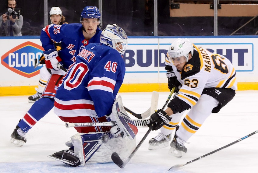 Brad Marchand of the Boston Bruins scores his 300th career goal at 7:51 of the third period against Alexandar Georgiev of the New York Rangers at Madison Square Garden on Friday. (USA TODAY Sports)
