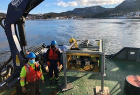 William Glatt, left, and Keely Lulwitz from Ocean Networks Canada were aboard the Marine Institute's Inquisitor vessel last month for the installation of the seafloor observatory in Conception Bay. — Contributed