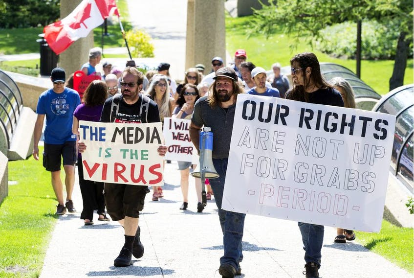 On the first day of Edmonton's mandatory indoor public space mask bylaw, approximately 50 anti-mask protestors marched from the Alberta Legislature to City Hall, Aug. 1, 2020.