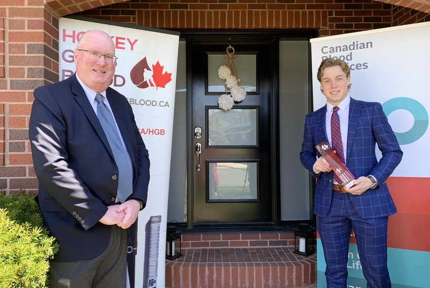Peter MacDonald, left, director of donor relations for Canadian Blood Services in Atlantic Canada and Ontario, presented the Dayna Brons Honorary Award to Charlottetown Islanders' goalie Matthew Welsh Wednesday in Halifax.