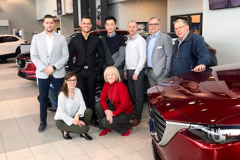 The Steele Mazda St. John's sales team would like you to test drive a Mazda and experience its affordable luxury. (Front row, from left: Kim Follett, Marie Riley. Back row, from left: Kory Waterman, Liam Furlong, Ian Wang, Greg Ryerson, Gerry Carew, Bob Rose. Missing from photo: Cathy Miller and Terry Nugent.) - Contributed.
