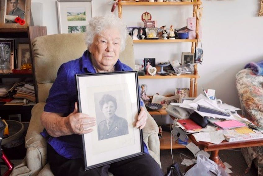 Scotland-born Anabella Mazur, 95, of Tatamagouche holds a portrait of herself from about 70 years ago as a member of the Royal Signal Corps during the Second World War. Mazur contributed to the war effort in London during the blitz and was nearly struck by a German V-1 rocket in 1944 during an attack on the city.