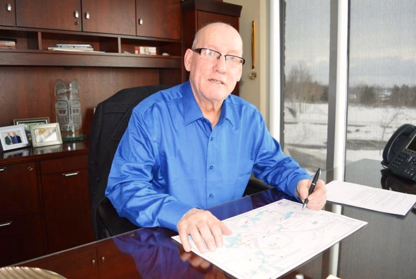 Membertou First Nation Chief Terry Paul reviews blueprints for the Churchill Crossing development that will begin construction this summer. It is located along the newly twinned section of Highway 125, connected to the aboriginal community via highway interchange. <br /><br />
