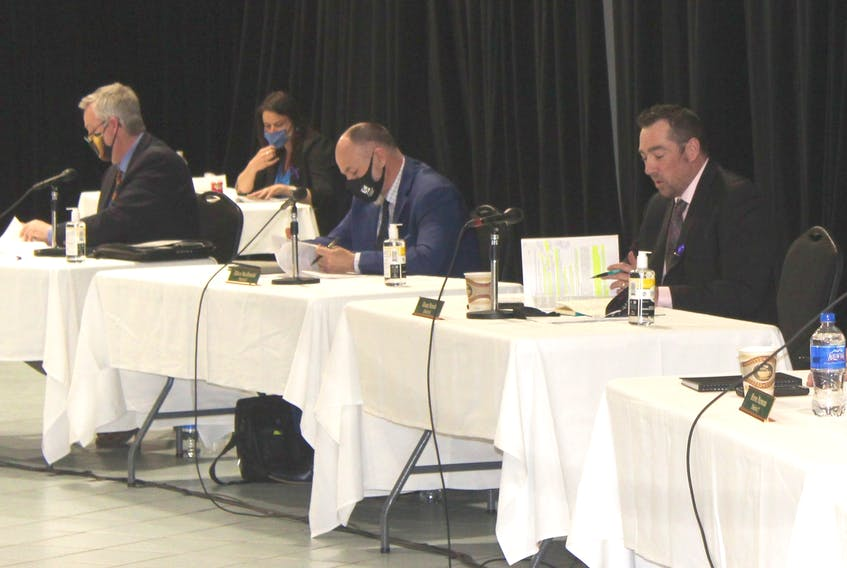 CBRM councillors Steve Gillespie, left, and Eldon MacDonald listen as Glenn Paruch delivers an amended motion on Tuesday night regarding a proposal for a medical clinic to operate at 46 Cottage Rd. — IAN NATHANSON/CAPE BRETON POST