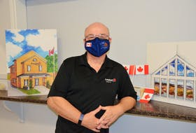 Volunteer Paul Murphy with renderings by interior designer Therese Harvey showing what the Wolfville Legion building will look like following an extensive renovation project. He points out that they're selling Legion masks like the one he's wearing as part of this year's Poppy Campaign. KIRK STARRATT