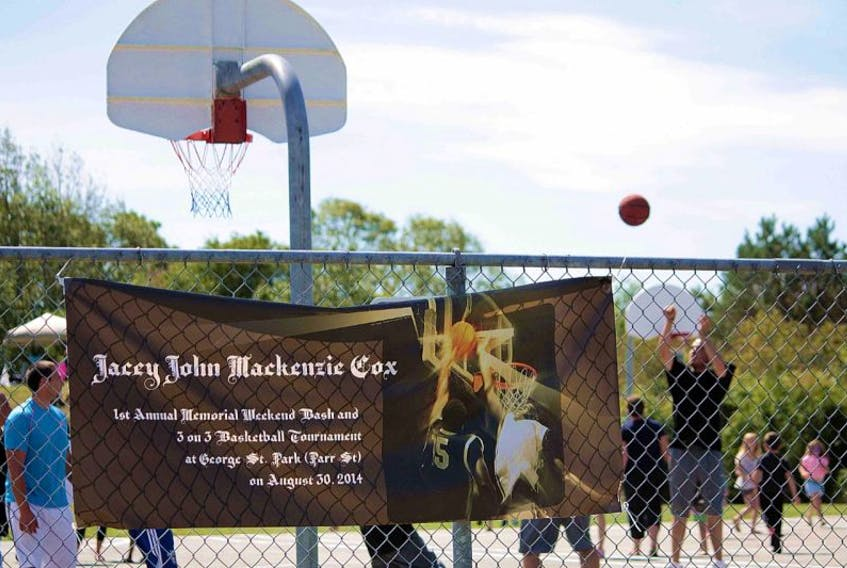 <p>Players at the 3-on-3 basketball tournament, held as part of the memorial fundraiser, reach for the ball at the George Street Park.</p> <p></p> <div></div>