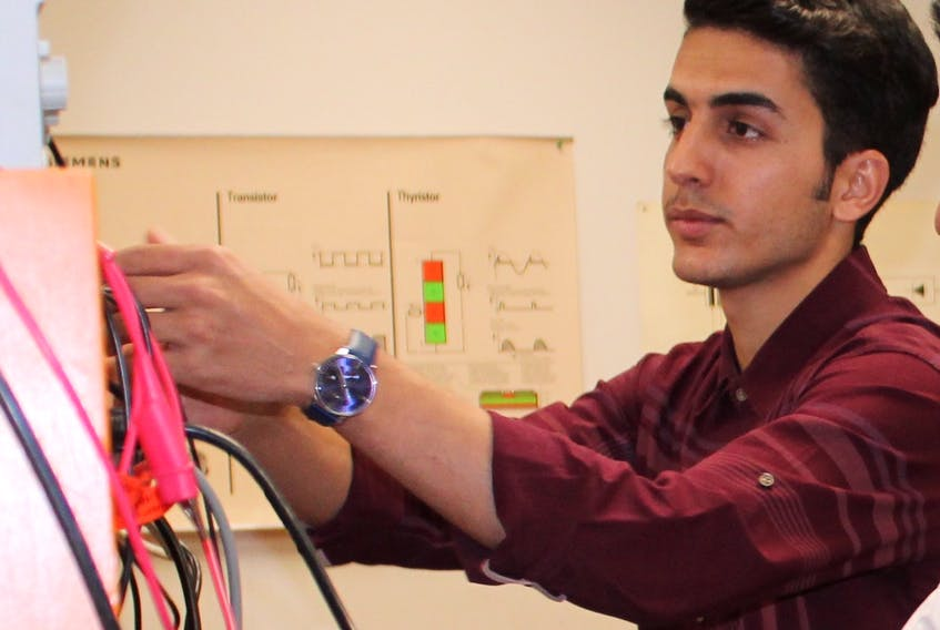 Mohammad Zamanlou at work in an electrical lab at Memorial University. -TELEGRAM FILE PHOTO
