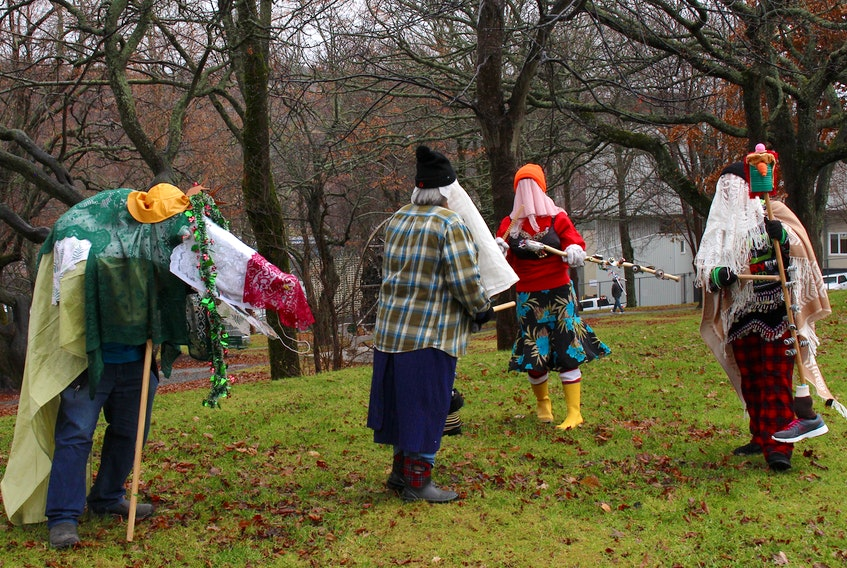 Hark! What's that noise in Victoria Park in St. John's? Oh, why it's (from left to right) Kyle Crumsick, Cheryl Stacey, Angie O'Brien and Myrtle Mitchell doing a jig. — Andrew Waterman/The Telegram