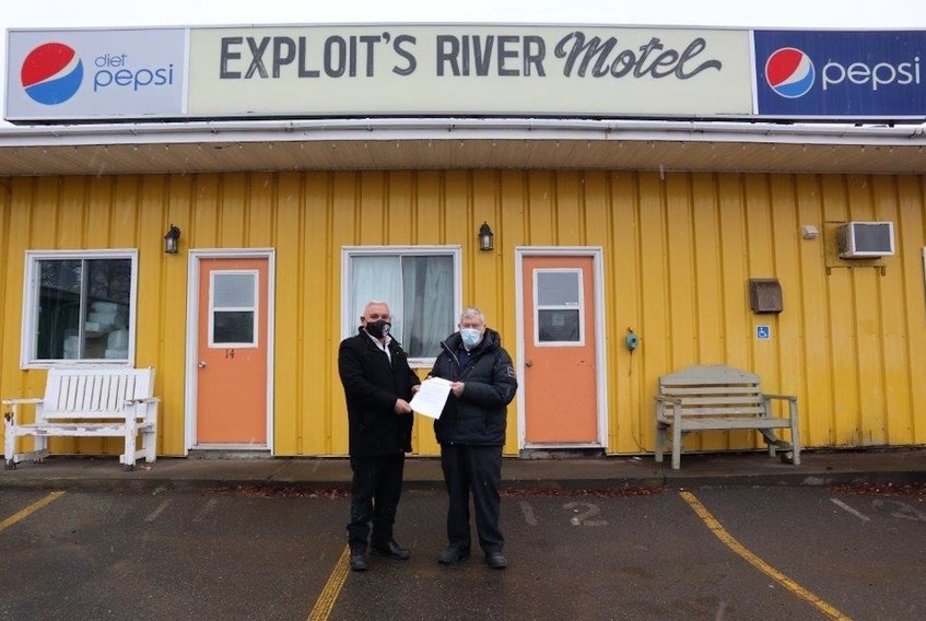 The Miawpukek First Nation recently bought the Exploits River Motel and the adjacent property. The property is the start for a multi-year tourism strategy that the band is developing. Shown here are Miawpukek First Nation Chief Mi'sel Joe (left) and previous vendor Henry Hutchings. Contributed photo