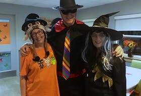 Rotarian Linda Crockett, bingo caller Ray MacNeil and Carol Miller get into the spirit during one of the Halloween celebrations at the New Dawn Guest Home. CONTRIBUTED