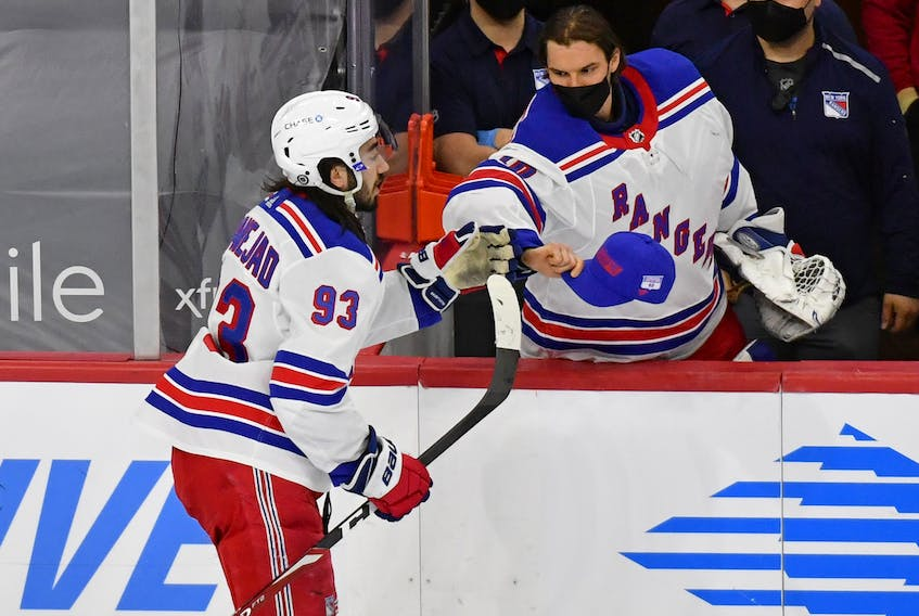 New York Rangers centre Mika Zibanejad is congratulated by goalie Alexandar Georgiev after completing his hat trick against Philadelphia last night. It was his second hat trick in eight days. He also added three assists against the Flyers.