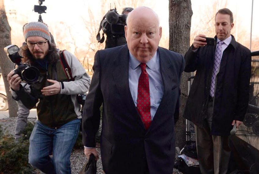 Suspended senator Mike Duffy arrives at the courthouse for his trial in Ottawa on Thursday.
