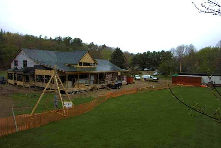"""Friday's weather is not fun for construction crews at Milford House in Annapolis County <a href=""""http://www.annapoliscountyspectator.ca/News/2014-05-18/article-3730401/Lodge-gone%2C-spirit-lives-on/1"""" target=""""_blank"""">where the lodge destroyed by fire a year ago is being rebuilt. http://www.novascotiawebcams.com/en/webcams/milford-house/<br /></a>"""