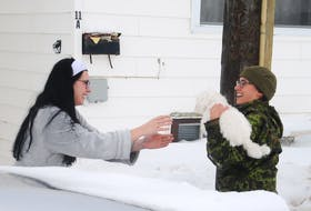 Royal Newfoundland Regiment reservist Sgt. Hannah Gaultois retrieved this dog that scampered out of a home on Franklyn Avenue Monday. ANDREW ROBINSON/THE TELEGRAM