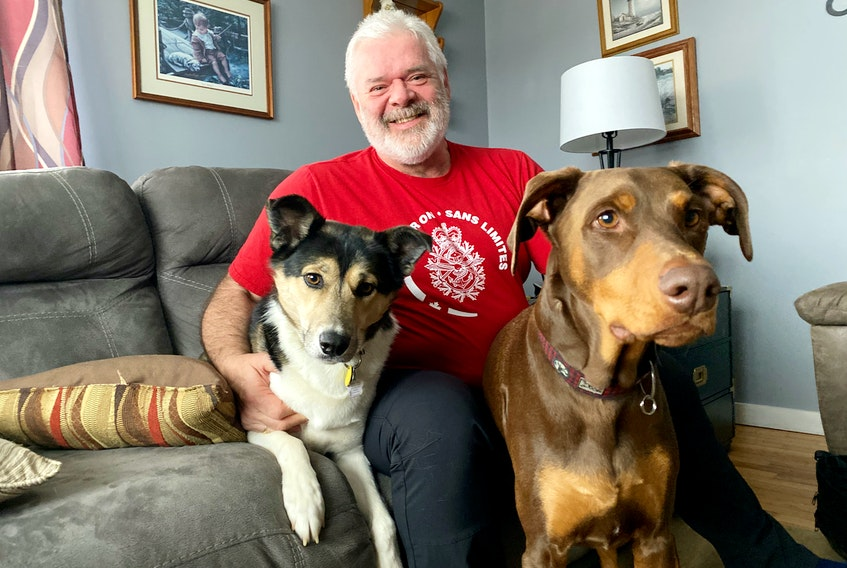 Four-legged friends Damien and Magnum with Bruce Rolfe. Carla Allen Photo
