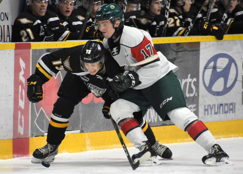 Halifax Mooseheads defenceman Cam Whynot, right, and Cape Breton Eagles forward Felix Lafrance battle for the puck during a 2019-20 QMJHL game in Sydney. - Jeremy Fraser /  SaltWire Network