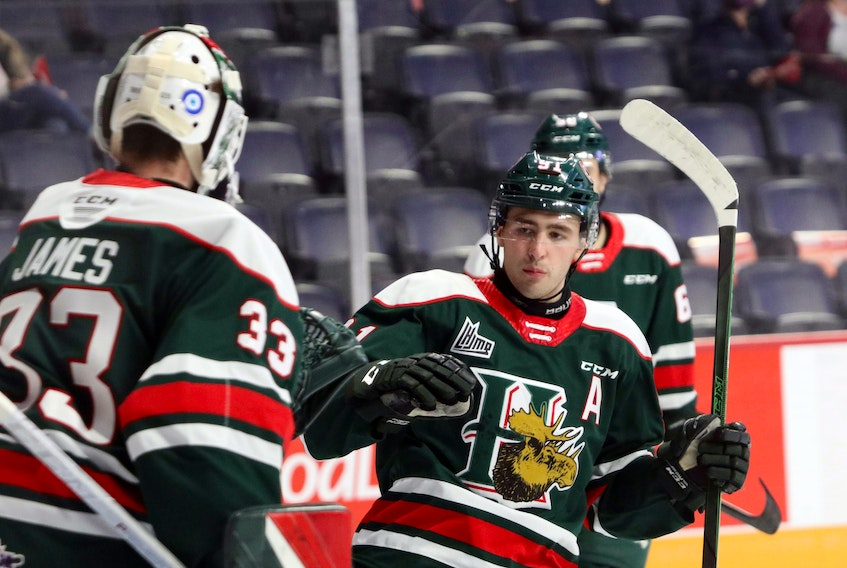Halifax Mooseheads centre Elliot Desnoyers and goalie Brady James celebrate a goal during a Nov. 6, 2020 game against the Charlottetown Islanders at the Scotiabank Centre. (ERIC WYNNE/Chronicle Herald)