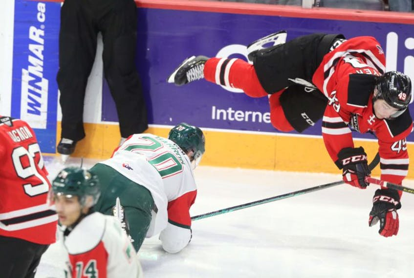 Halifax Mooseheads defenceman Justin Barron trips up Quebec Remparts forward Edouard Cournoyer early in the first period of Friday's QMJHL game at the Scotiabank Centre. (ERIC WYNNE/Chronicle Herald)