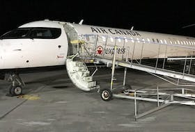 This Air Canada plane at the J.A. Douglas McCurdy Sydney Airport, early Monday morning was the last commercial flight to leave the facility. Air Canada has suspended operations indefinitely. Contributed • Sydney Airport Authority