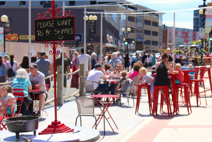 During peak hours on sunny days, waiting for a table is not uncommon at the newly constructed patios in downtown St. John's. Pictured here is the patio of Mussels On The Corner, a seafood restaurant owned by Brenda O'Reilly and located at 318 Water Street. – Andrew Waterman/The Telegram